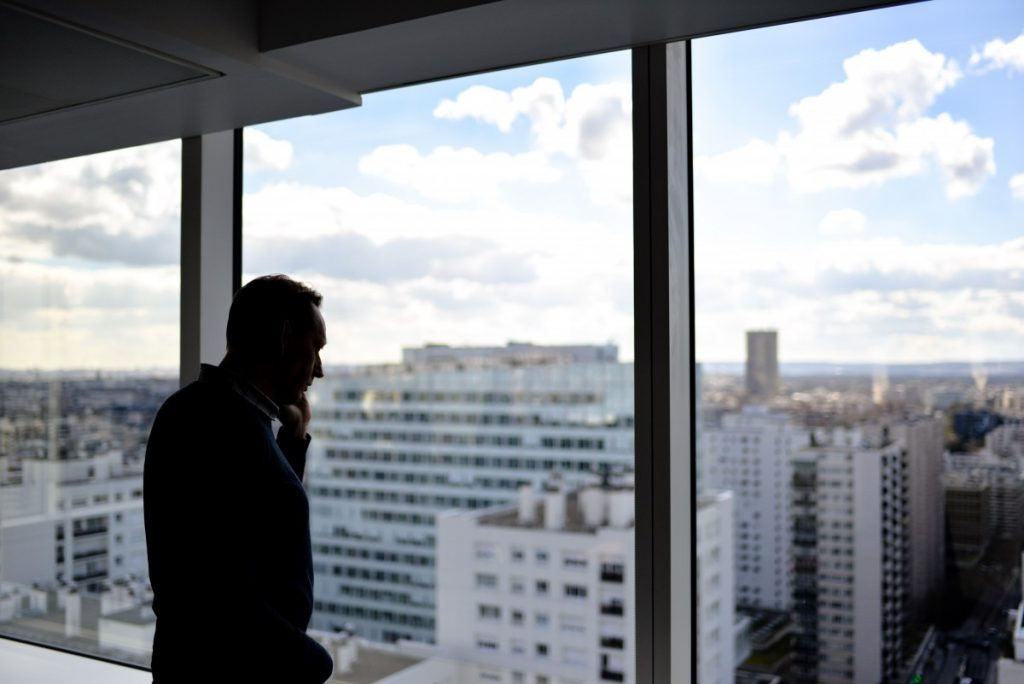 man listening to an earnings call